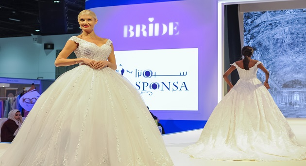 9264843d8 معرض عروس دبي 2017 إبداع في تصاميم فساتين الأعراس والحفلات - أوقات دبي